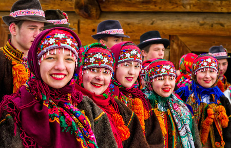 ethnic customs: Uzhgorod, Ukraine - January 15, 2017: Female folklore collective performs during the seventh ethnic festival Christmas Carols in the old village. During the festival, visitors can familiarize with a variety of Christmas customs, caroling and celebrations  Editorial