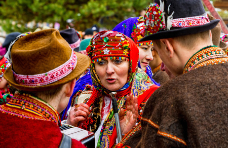 cele: Uzhgorod, Ukraine - January 15, 2017: Participants in folklore collectives talking during the seventh ethnic festival Christmas Carols in the old village. During the festival, visitors can familiarize with a variety of Christmas customs, caroling and cele