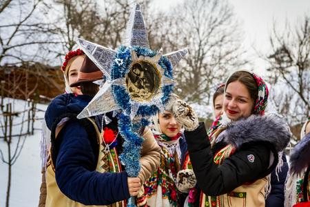 Uzhgorod, Ukraine - January 15, 2017: Female folklore collective performs during the seventh ethnic festival Christmas Carols in the old village. During the festival, visitors can familiarize with a variety of Christmas customs, caroling and celebrations  Éditoriale