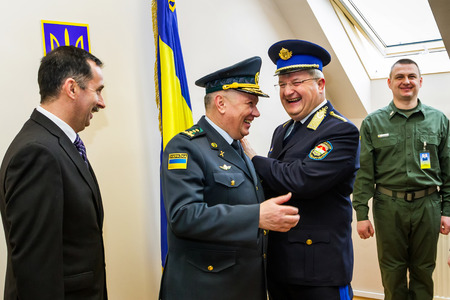 police state: Zahony, Hungary - January 25, 2017: Head of the State Borderguard Service of Ukraine, colonel general Viktor Nazarenko (C) and the deputy police chief - chief of law enforcement of Hungary, major general Zsolt Halmosi (R2) communicate during the opening o Editorial