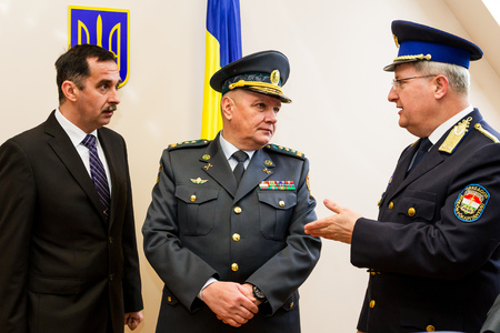 police state: Zahony, Hungary - January 25, 2017: Head of the State Borderguard Service of Ukraine, colonel general Viktor Nazarenko (C) and the deputy police chief - chief of law enforcement of Hungary, major general Zsolt Halmosi (R) communicate during the opening of Editorial