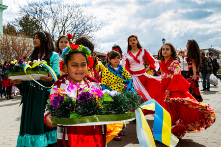 Uzhhorod, Ukraine - April 7, 2017: Participants in the celebration of the International Roma Day perform Romany folk dances in the city center. Editorial