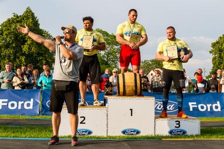 Storozhnitsa, Ukraine - May 21, 2017:  (L- r) President of the Strongman Federation of Ukraine Sergiy Konyushok, iranian athlete Ali Agbar (2nd place), Alexey Novikov (1st place) and Andrew Burshtin (3rd place) during the awarding of the winners of the fi Editorial