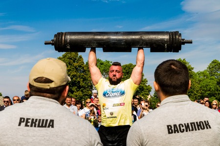 Storozhnitsa, Ukraine - May 21, 2017: Strongman Roman Hnydan perform exercises during the first round of the strongman Cup of Ukrain at the central stadium of the village. Editorial
