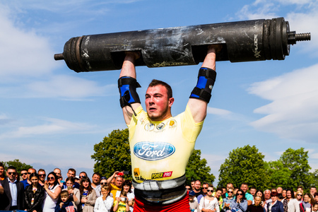 Storozhnitsa, Ukraine - May 21, 2017: Strongman Alexey Novikov perform exercises during the first round of the strongman Cup of Ukrain at the central stadium of the village.