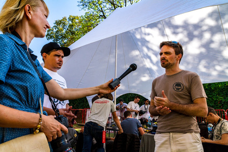 Uzhgorod, Ukraine - September 2, 2017: The first world champion in drone racing Chad Nowak from Australia (r) communicates with reporters during the Eastern European Cup 2017 on drone racing.