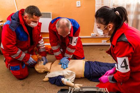Uzhhorod, Ukraine - November 16, 2017: The paramedics brigade performs artificial respiration on a dummy during the competition. Publikacyjne