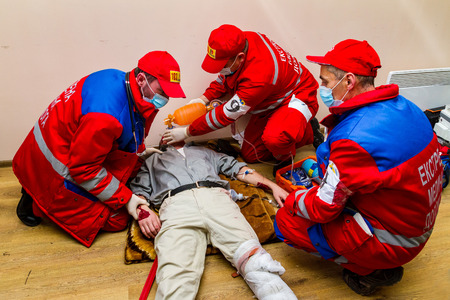Uzhgorod, Ukraine - November 16, 2017: The emergency medical teams assisting conditional victim during the competition.