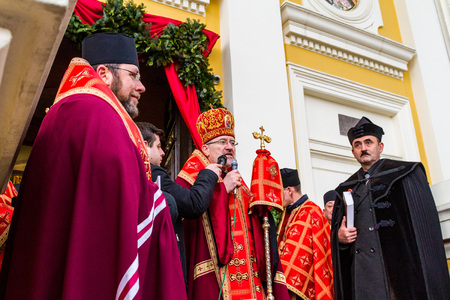 Uzhgorod, Ukraine - March 11, 2018: The priests bless the participants in the procession during the cross march marking the Veneration of the Cross Sunday in Uzhgorod.