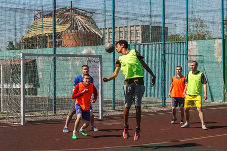 Uzhgorod, Ukraine - April 21, 2018: Young people play amateur mini-football on the field in one of the citys courtyards.