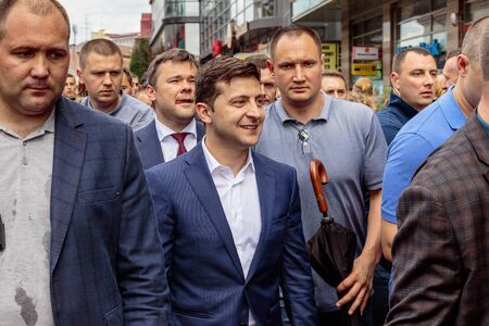 President of Ukraine Volodymyr Zelenskyy (Ð¡), surrounded by personal security, walks through the city center during a working visit in Uzhgorod, Ukraine. July 6, 2019.