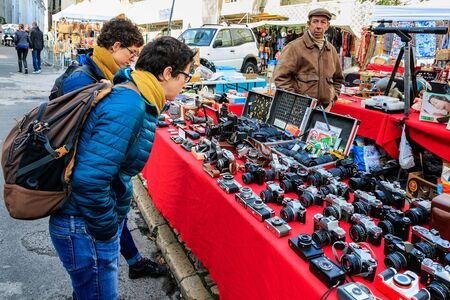 Tourists view vintage photographic equipment at a flea market in Lisbon, Portugal, January 7, 2020.