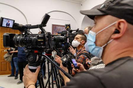 Mukachevo, western Ukraine - June 11, 2020: Videographers in protective masks during the working visit of Speaker of the Ukrainian parliament Dmytro Razumkov to Mukachevo, western Ukraine.