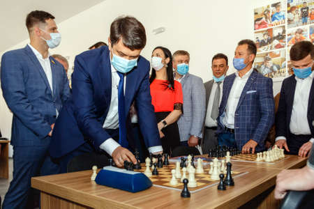 Mukachevo, western Ukraine - June 11, 2020: Speaker of the Ukrainian parliament Dmytro Razumkov (L) plays chess during the opening of the renovated Palace of Culture and Arts.