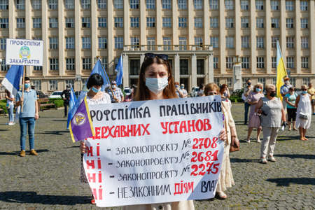 Uzhgorod, western Ukraine - June 30, 2020: Union workers in protective masks are protesting against antiprofessional bill number 2681 during quarantine. Éditoriale