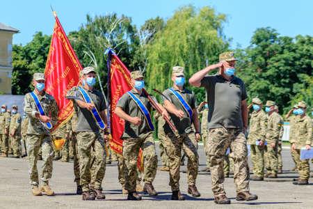 Uzhgorod, Western Ukraine - July 10, 2020: Ukrainian army soldiers wearing face masks as preventive measures against Coronavirus (COVID-19) during the award ceremony.