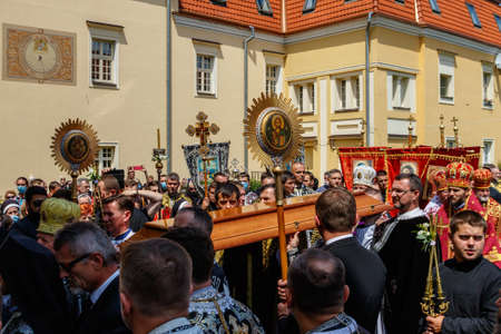 Uzhgorod, Ukraine - July 20, 2020: Priests carry the lid of the coffin during the farewell ceremony with Bishop of Mukachevo Greek Catholic Diocese Milan Shashik.