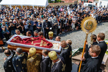 Uzhgorod, Ukraine - July 20, 2020: Priests carry the coffin during the farewell ceremony with Bishop of Mukachevo Greek Catholic Diocese Milan Shashik. Éditoriale
