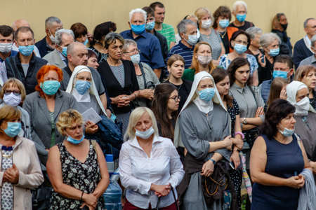 Uzhgorod, Ukraine - July 20, 2020: Nuns in protective masks and parishioners pray during the farewell ceremony with Bishop of Mukachevo Greek Catholic Diocese Milan Shashik. Éditoriale