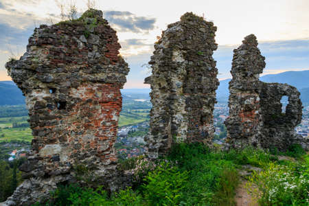 Ruins of old hungarian castle at sunset in Khust city, western Ukraine.