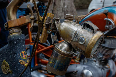 Antique carbide lamp on a vintage bicycle. History in detail.