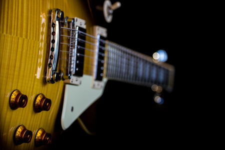 amp: Electric guitar isolated on a black background
