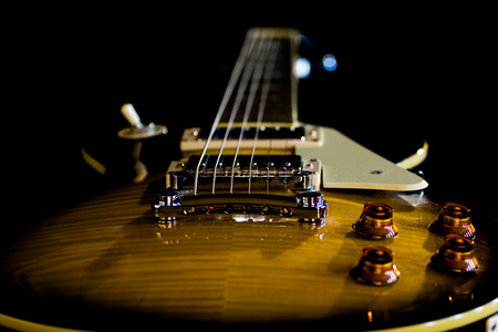Electric guitar isolated on a black background