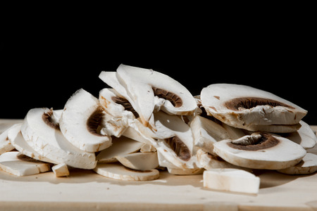 button mushrooms: Fresh whole white button mushrooms, or agaricus, in a bowl on a rustic wooden Stock Photo