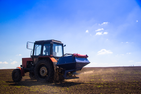 spaying: Tractor Spaying a field in the spring accompanied