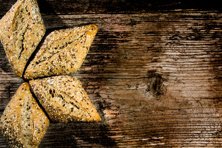 Bread loaf on a rustic wood . Free space for text. Top view