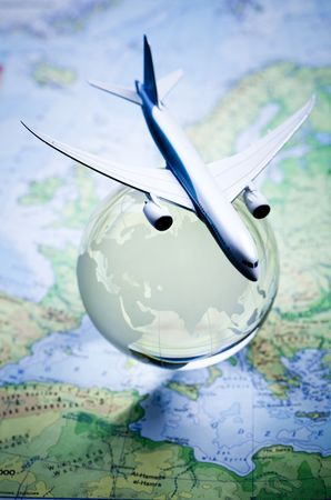 oversea: Airliner with a globe Stock Photo