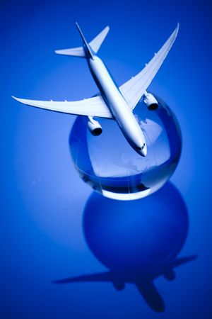 oversea: Airliner with earth in the blue background