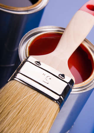 Cans with paint and brushes on the blue background Stock Photo - 952241