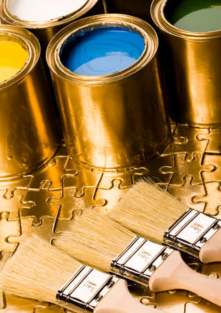 Paint and gold cans photo
