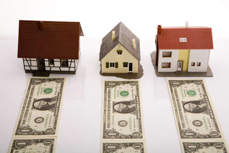 reclaiming: House for sale Dollars  Stock Photo