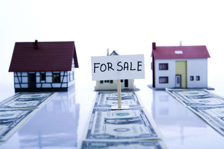 Dollars and Houses Stock Photo - 3273006