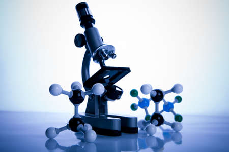 Microscope and atom  Stock Photo - 3493562