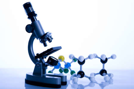 Microscope and atom  Stock Photo