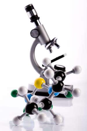 Microscope and atom  Stock Photo - 3493555