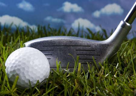 Golf ball on tee with club  photo