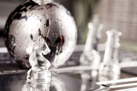 travel features: Globe and chess Stock Photo