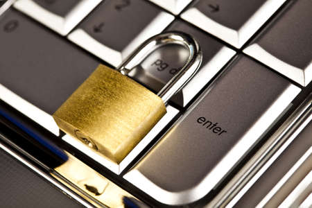Padlock and notebook computer Stock Photo - 5094038