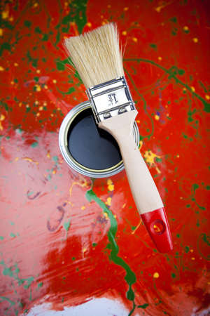 Cans and paint and brush on the Colorful background photo