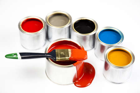 flat brush: Cans and paint on the colourful background Stock Photo