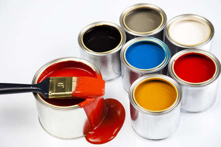 paint can: Cans and paint on the colourful background Stock Photo