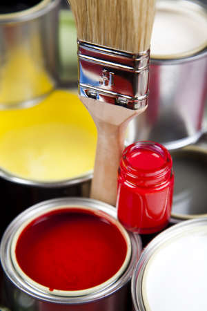paintjob: Cans and paint and brushes on the Colorful background Stock Photo