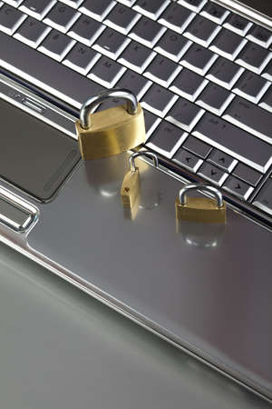 Padlock and notebook computer photo