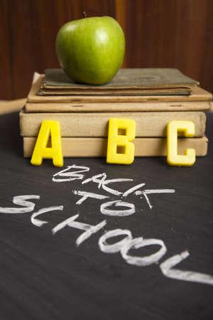 periods: Apple on a blackboard  Stock Photo