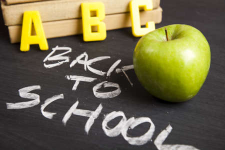 learning materials: Apple on a blackboard   Stock Photo