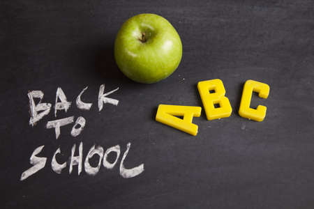 Apple on a chalkboard - healthy breakfast at school  Stock Photo - 5427867